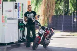 motorcycle rider at gas station