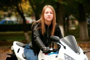 girl in leather jacket on motorcycle